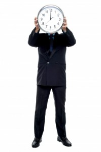 Man Holding Clock